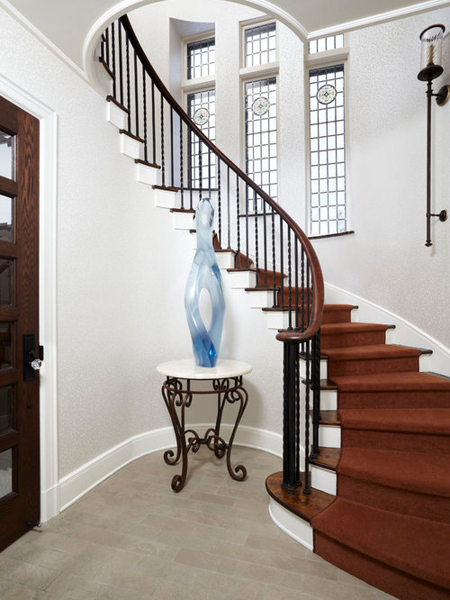 Example Of A Classic Wooden Curved Staircase Design In Minneapolis
