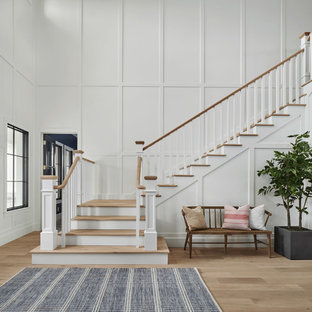 Inspiration for a large country wooden l-shaped wood railing staircase remodel in Phoenix with painted risers
