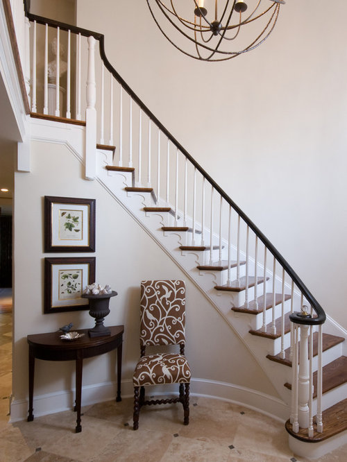 Foyer with curved staircase houzz for Foyer staircase decorating ideas