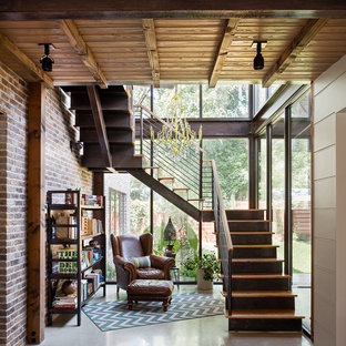 Staircase - rustic wooden staircase idea in Austin with metal risers