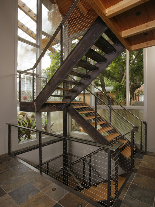 Example Of A Minimalist Floating Staircase Design In Seattle