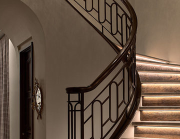 Lighted Stone Stair Treads with Iron Balustrade