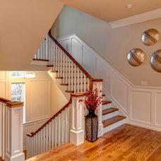 Traditional Staircase by Farinelli Construction Inc