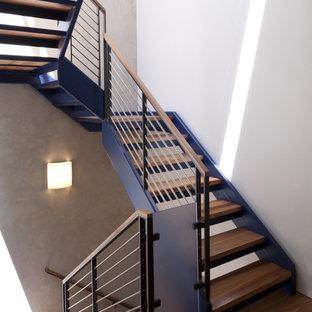 Ispirazione per una scala minimalista con nessuna alzata e parapetto in cavi