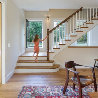 Example of a mid-sized country wooden l-shaped wood railing staircase design in Boston with painted risers