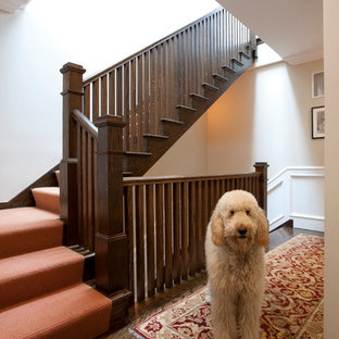 Example of a classic wooden wood railing staircase design in Chicago with wooden risers