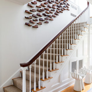 Inspiration for a huge transitional wooden l-shaped staircase remodel in Bridgeport with painted risers