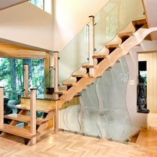Contemporary Staircase by DeSantis Designs Inc