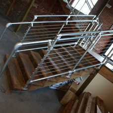 Contemporary Staircase by Framework Design, Inc.