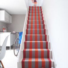 Contemporary Staircase by Roger Oates Floors & Fabrics