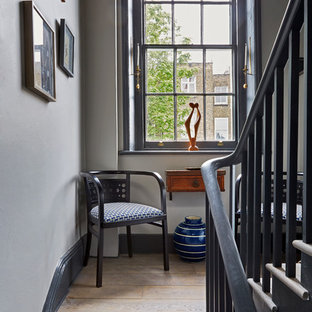 Staircase - transitional wooden u-shaped staircase idea in London with wooden risers