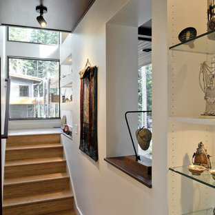Trendy wooden staircase photo in Seattle with wooden risers