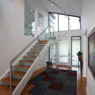 Photo of a contemporary glass railing staircase in San Francisco.