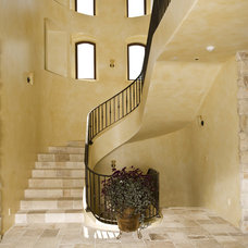 mediterranean staircase by Conrado - Home Builders