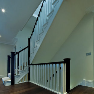 Inspiration for a mid-sized contemporary painted l-shaped staircase remodel in Cambridgeshire with painted risers