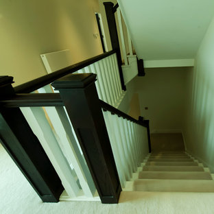 Mid-sized trendy painted l-shaped staircase photo in Cambridgeshire with painted risers