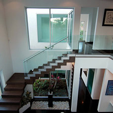 Modern Staircase by Home & Commercial Designs