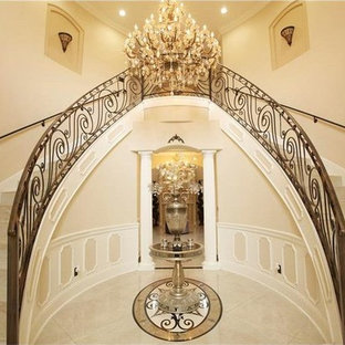 Photo of a mid-sized mediterranean tile curved staircase in Orlando with tile risers and wood railing.