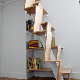 Modern wood staircase in New York with wood risers.