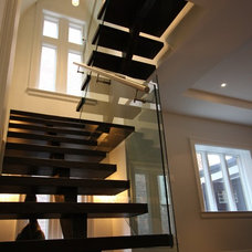 Contemporary Staircase by M-Squared Contracting Inc.