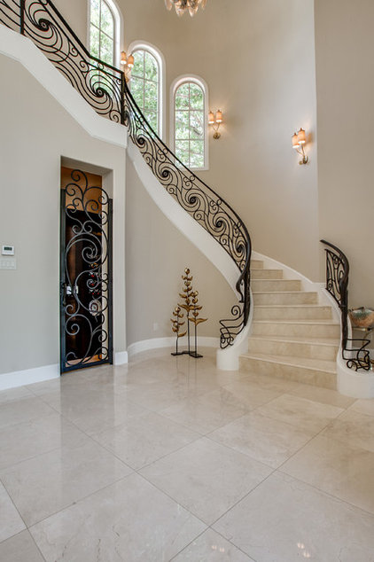 Mediterranean Staircase by Bella Vita Custom Homes