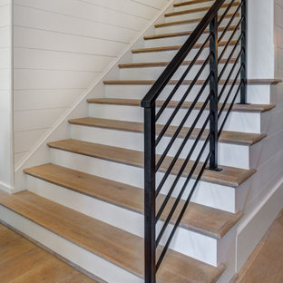 Staircase - large farmhouse wooden straight metal railing staircase idea in Charlotte with painted risers