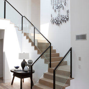 Inspiration For A Large Beach Style Wooden Glass Railing Staircase Remodel  In Los Angeles