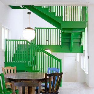 Inspiration for a beach style painted l-shaped staircase remodel in San Diego with painted risers