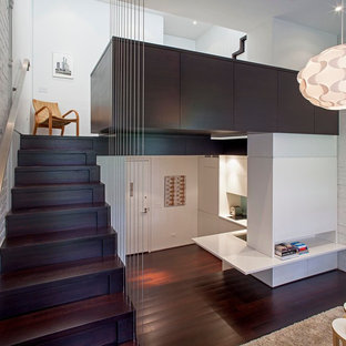 Inspiration for a small modern wooden straight staircase remodel in New York