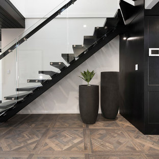This is an example of a contemporary wood straight staircase in Sydney.