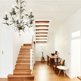Design ideas for a transitional wood l-shaped staircase in Sydney.
