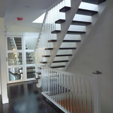 Contemporary Staircase by CanTrust Contracting Group