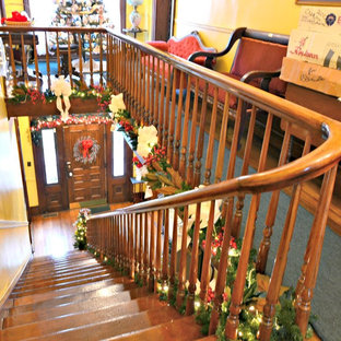 This is an example of a small victorian wood u-shaped wood railing staircase in Other with wood risers.