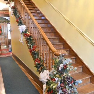 Example of a small ornate wooden u-shaped wood railing staircase design in Other with wooden risers