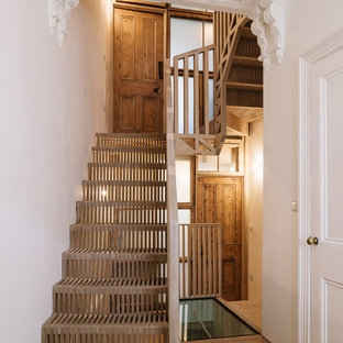 Inspiration for a scandi wood u-shaped wood railing staircase in London with wood risers.