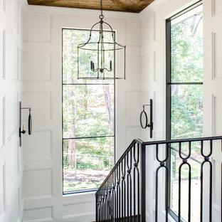 Foto de escalera de estilo de casa de campo con escalones de madera y barandilla de metal