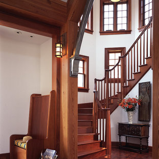 Large arts and crafts wooden curved wood railing staircase photo in Philadelphia with wooden risers