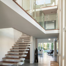 Contemporary Staircase by Proto Homes / Group F Builders, Inc