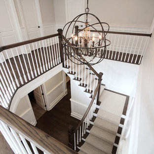 Large transitional wooden l-shaped wood railing staircase photo in New York with painted risers