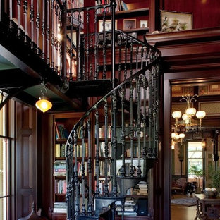 This is an example of a victorian metal spiral metal railing staircase in San Francisco with metal risers.