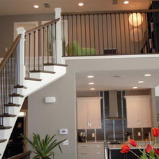 Contemporary Staircase by McGUIRE CUSTOM HOMES