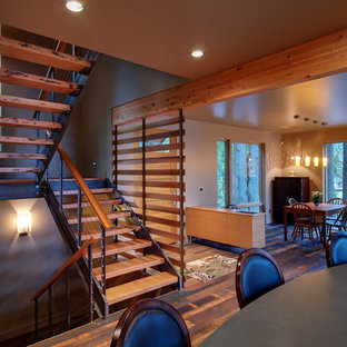 Example of a trendy wooden u-shaped open staircase design in Other
