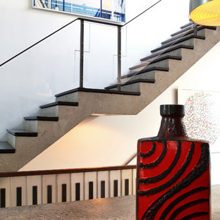 Inspiration for a modern wooden straight glass railing staircase remodel in New York