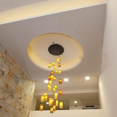 Contemporary Staircase by Galilee Lighting