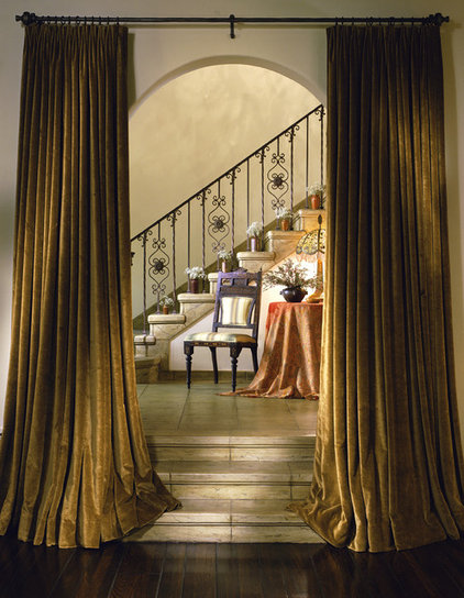 mediterranean staircase by Tommy Chambers Interiors, Inc.
