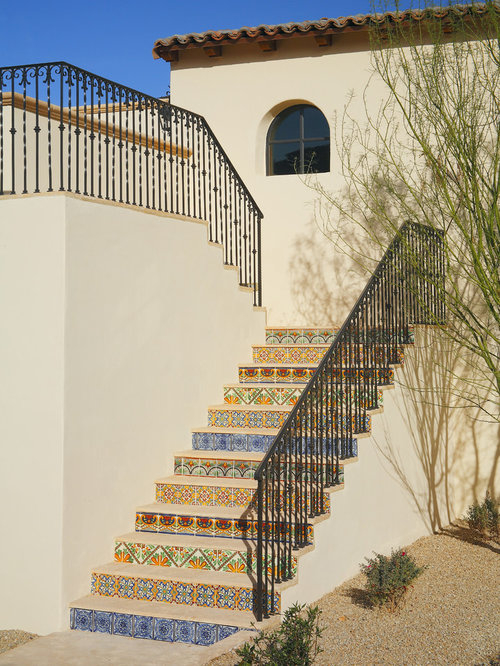 Inspiration For A Mediterranean Wooden U Shaped Staircase Remodel In Phoenix