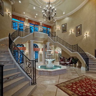 Tuscan curved staircase photo in Tampa