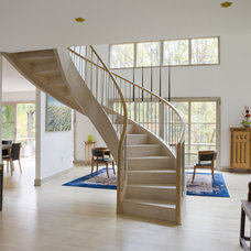 Contemporary Staircase by SAI Contracting