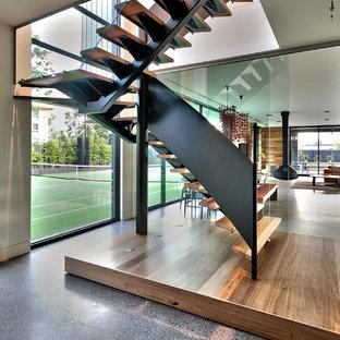 Modelo de escalera en L, actual, de tamaño medio, sin contrahuella, con escalones de madera
