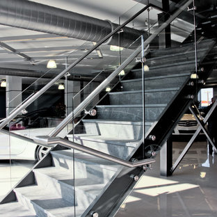 Example of a huge minimalist tile straight staircase design in New York with glass risers